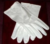 White cotton gloves with mother of pearl button wrist fastening and tri back stitching